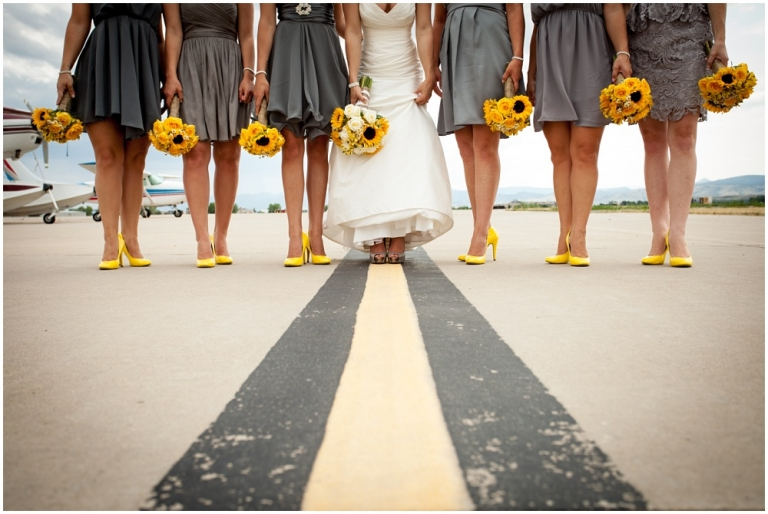 A bridal party with sunflower bouquets on a runway