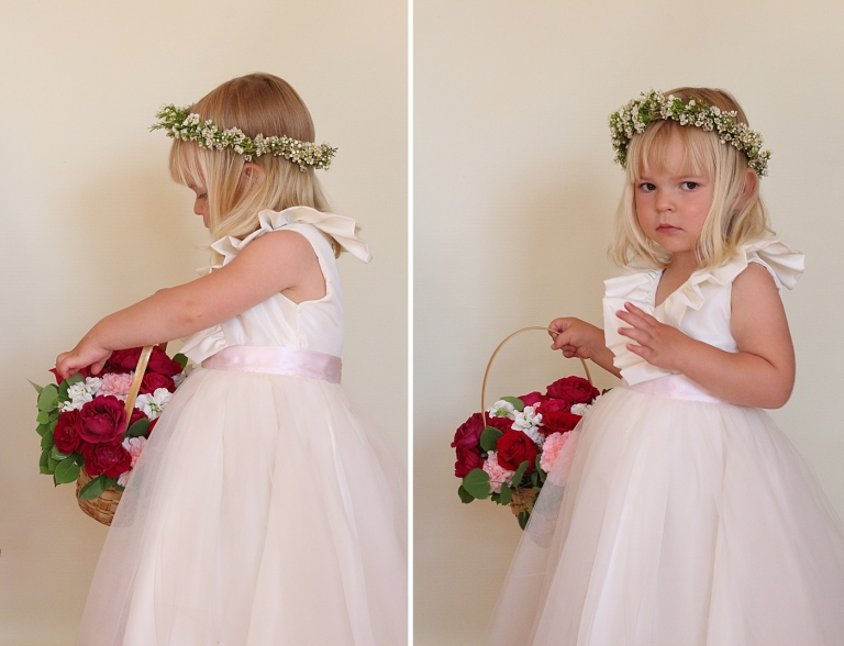 a flower girl is touching her flower basket