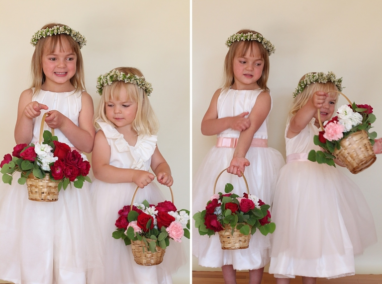 two flower girls holding a basket with flowers