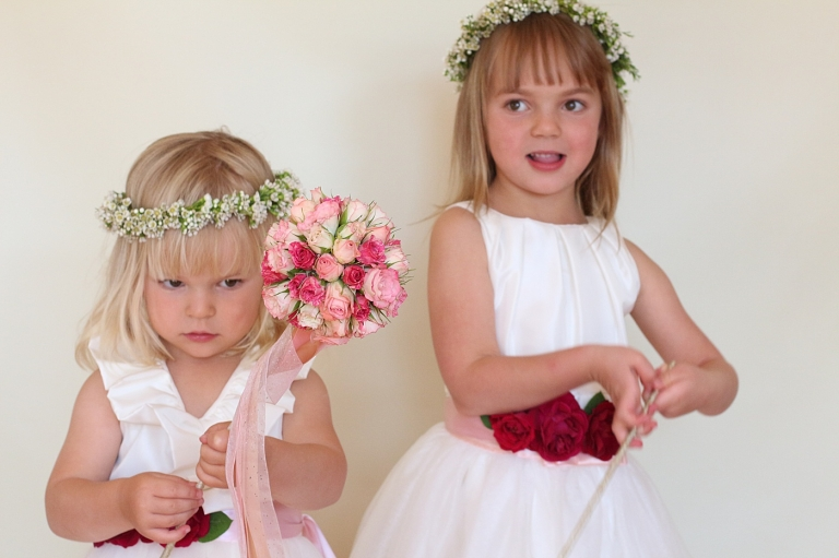 twop flower girls playing with flower wands