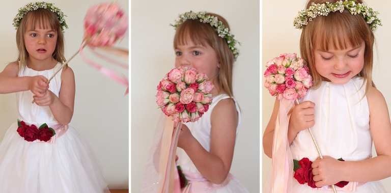 a flower girl playing with her flower wand