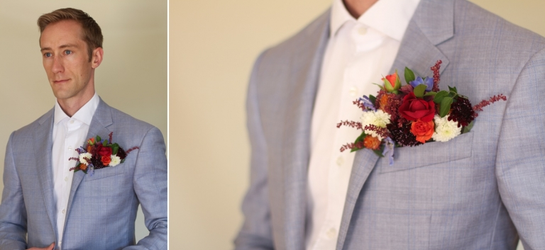 man wearing colorful flowers in his pocket square
