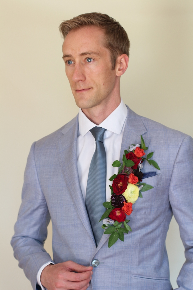 a jacket lapel covered in flowers