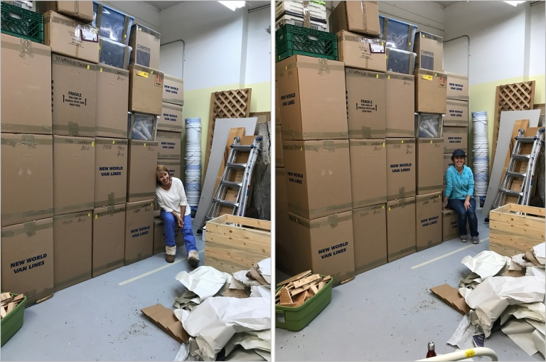 woman leaning against a pile of boxes