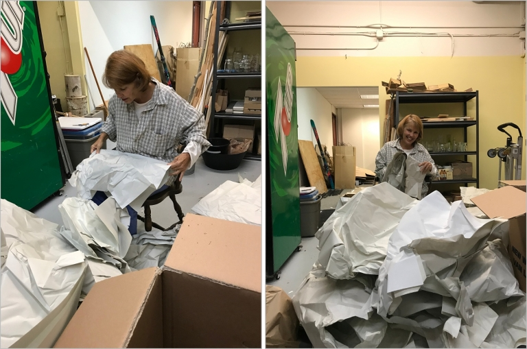 lady unpacking moving boxes and folding paper