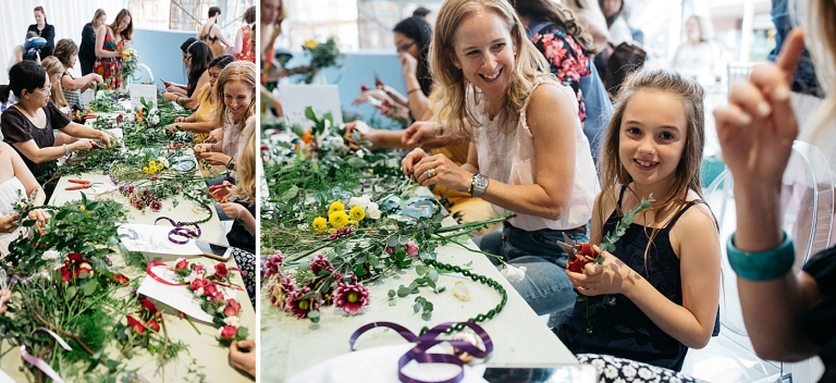a table full of women making flower crowns