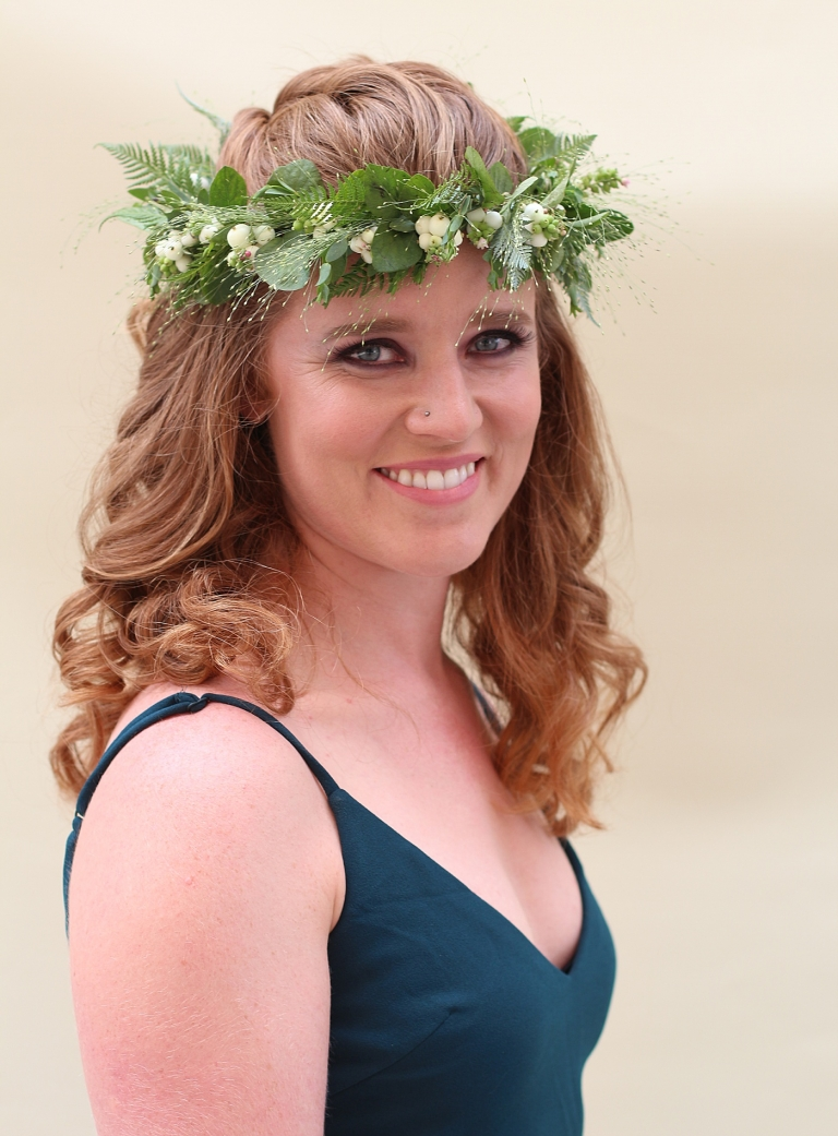 bride wearing greenery crown