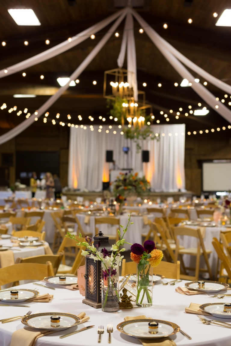 wedding reception dinner tables with flowers