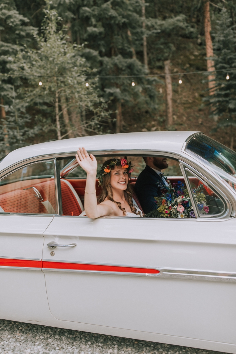bride and groom in a car