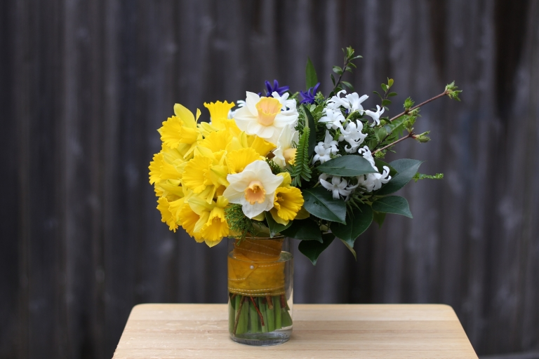 green, yellow, and white daffodil bouquet