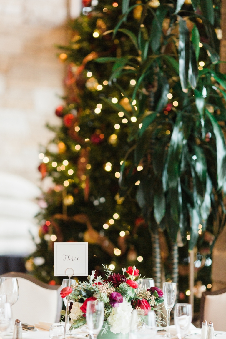 Floral centerpiece next to Christmas tree