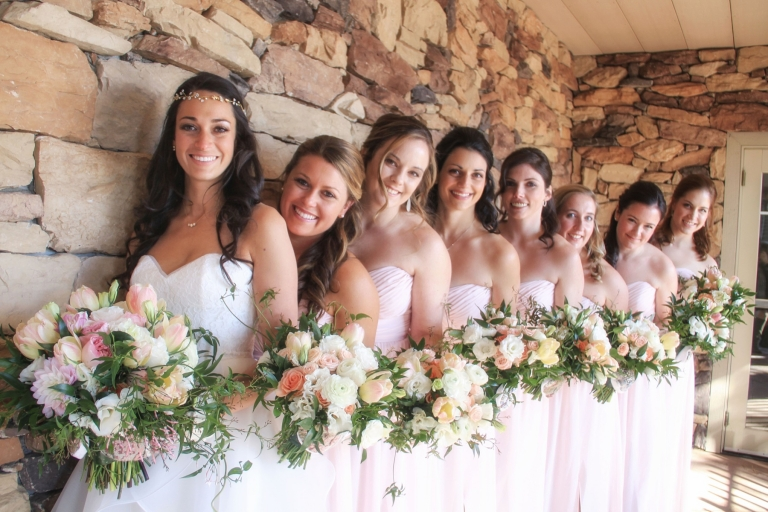 bridal party with lush blush wedding bouquets