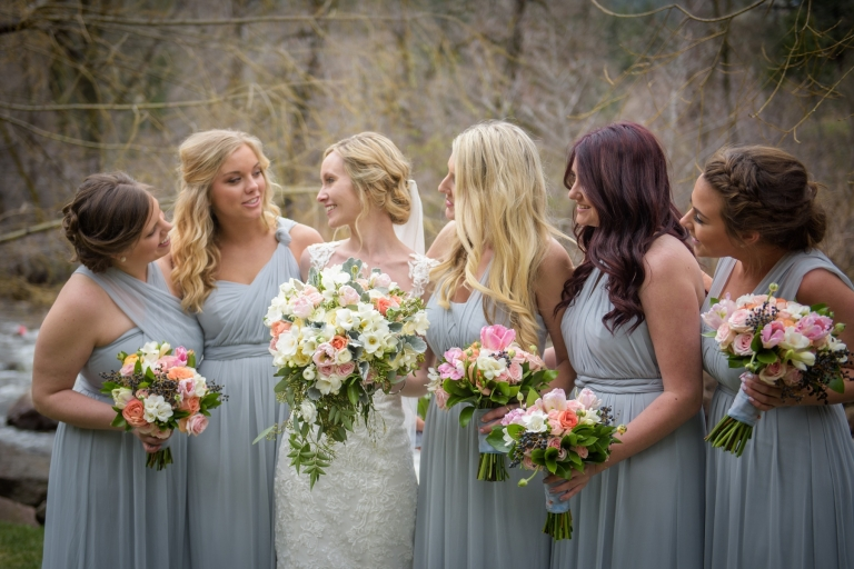 bridal party holding spring bouquets