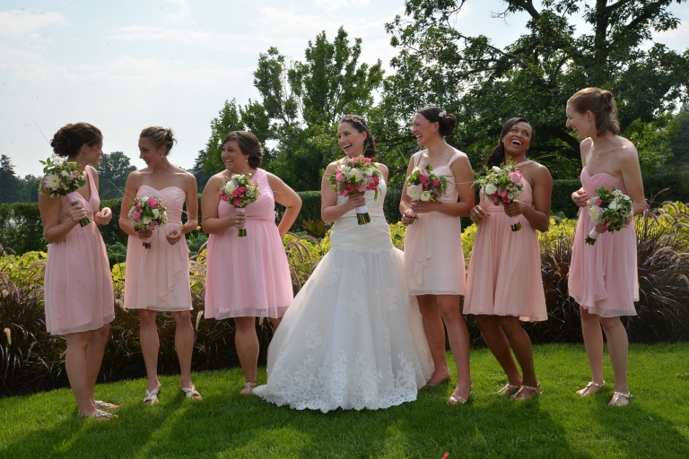 bridal party with pink dresses and pink bouquets