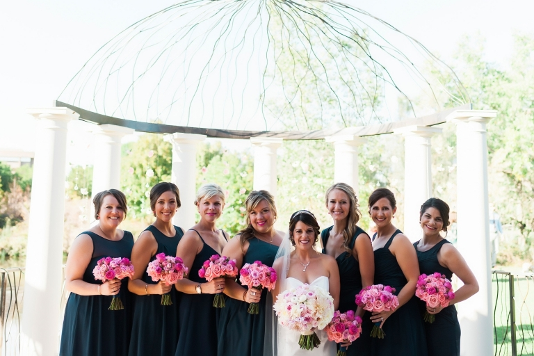 bridal party with hot pink bouquets