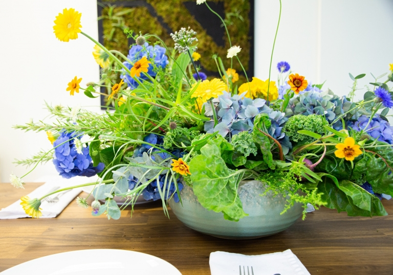 flowers and food in a salad bowl