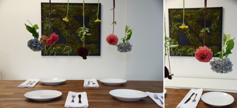 flowers hanging over a dining table