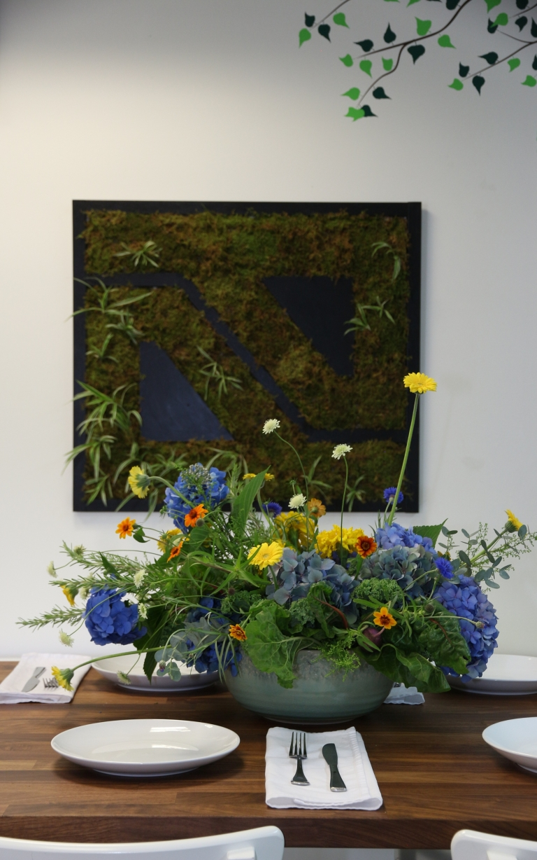 flowers and leafy greens in a salad bowl