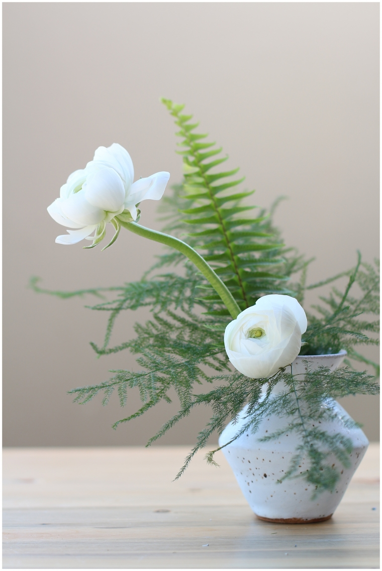 clay bud vase with white flowers