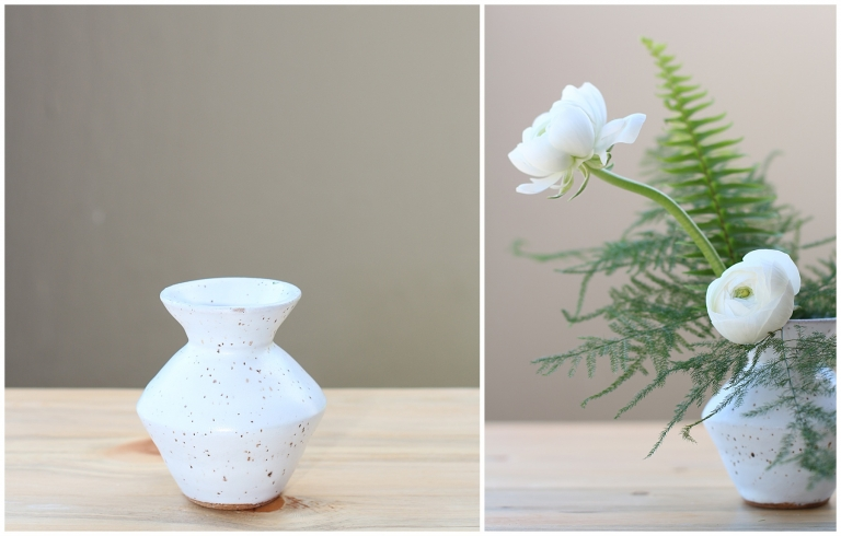 white flowers and ferns in a white bud vase